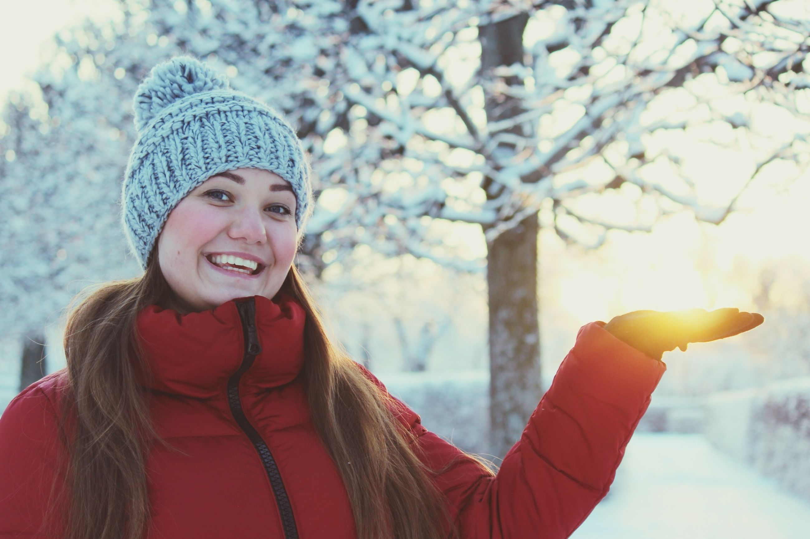 winter, cold temperature, snow, season, lifestyles, focus on foreground, warm clothing, leisure activity, headshot, holding, person, weather, casual clothing, waist up, looking at camera, standing, front view, knit hat