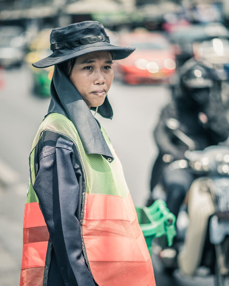 Local Bangkok street sweeper Street Sweeper Cleaner Worker High Visibility Yellow Color Hat Roadside Thailand Bangkok Focus On Foreground Real People Portrait Waist Up Side View Adult Incidental People Standing Lifestyles Sunny Sweeper Sweeping