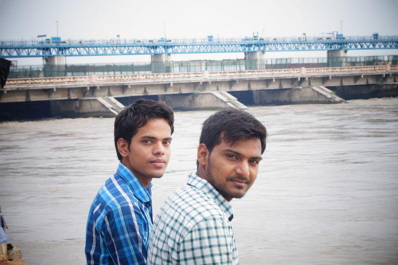 Portrait Of Male Friends By River