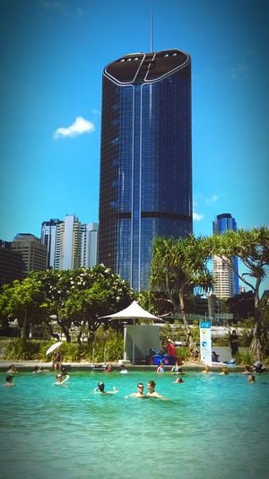 Skyscraper City Water Urban Skyline Cityscape Outdoors Summer Sand Swim Hot Weather Hotday Dayoutwithkids Manmadebeach Beautiful Day Architecture Building Exterior Clear Sky Sky Day Illuminated FunInTheSun☀️
