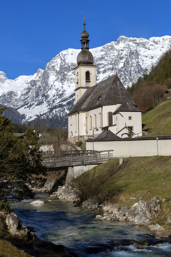 Religion Belief Place Of Worship Architecture Built Structure Water Mountain Spirituality Building Nature Sky Building Exterior Cold Temperature Day Snow Winter No People Outdoors Snowcapped Mountain Mountain Peak Ramsau  Ramsaubeiberchtesgaden