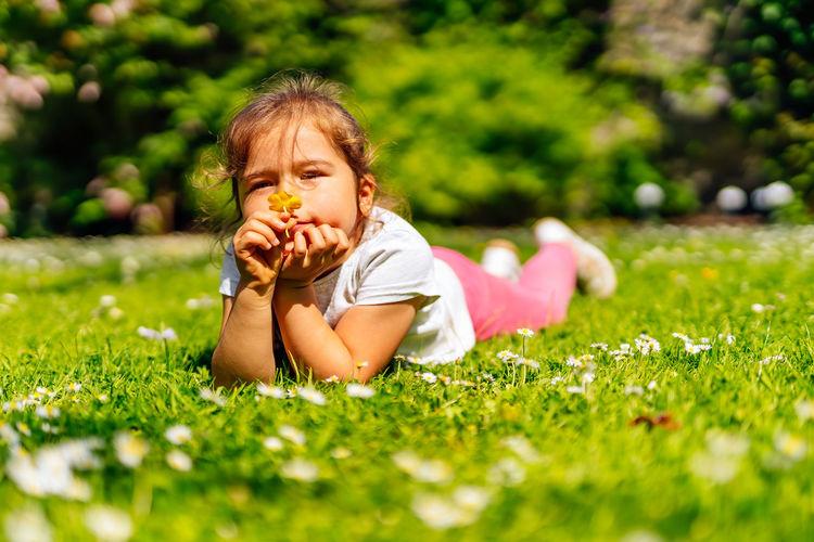 Portrait of cute baby girl on field