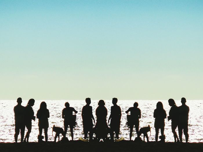 Surrealistic Sunset 2 Women Group Of People EyeEm Selects Los Angeles, California Sunset Sunset Silhouettes Mirrorimage Surreal Surrealist Art Surrealism Water Men Beach Sea Full Length Togetherness Standing Silhouette Clear Sky Ocean Shore
