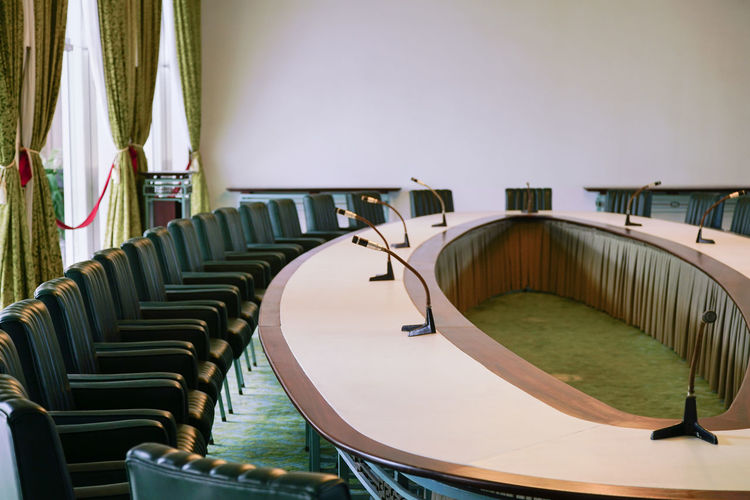 Empty chairs and table in conference room