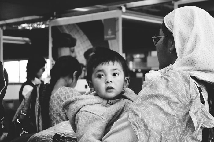 Up Close Street Photography Hello angel. Baby Angel Baby Portrait B&w Street Photography Black And White B&W Collection Streetphotography Stranger Eyes Are Soul Reflection Innocent Airport Waiting The Week On Eyem Carrying Baby Mother And Baby Wondering Eyelashes Kid Child The Portraitist - 2016 EyeEm Awards The Street Photographer - 2016 EyeEm Awards Feel The Journey Snap A Stranger