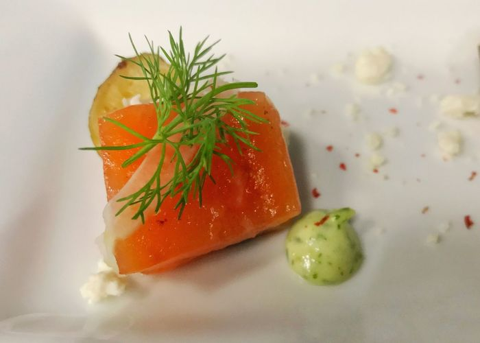 Salmon appetizer. Appetizer Salmon White Plate Horizontal Red Pepper Flakes Food Freshness Raw Salmon Seafood Fish Close-up Ready-to-eat Healthy Eating Food Stories
