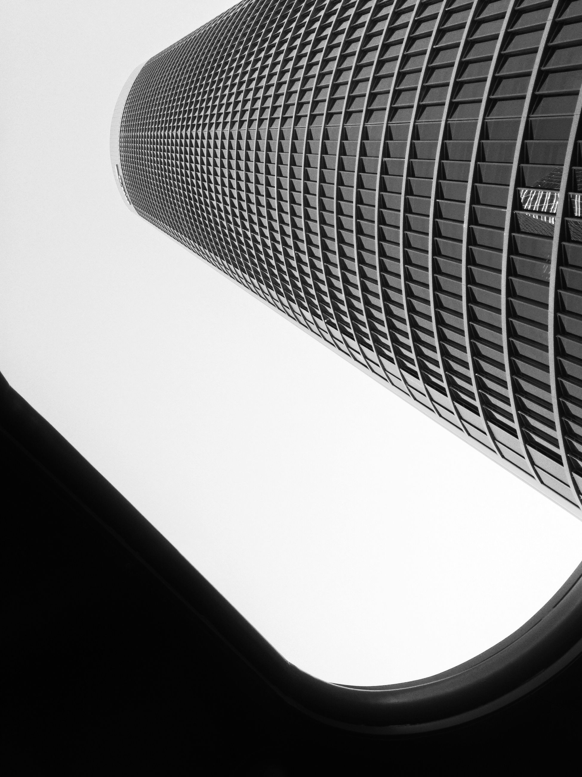 architecture, built structure, low angle view, building exterior, modern, building, clear sky, city, office building, tower, tall - high, directly below, skyscraper, architectural feature, no people, pattern, copy space, sky, day, outdoors
