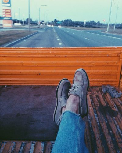 Low Section Person Personal Perspective Relaxation Shoe Sitting Men Road Legs Crossed At Ankle Resting Human Foot Solitude Day Casual Clothing Sky Distant travel