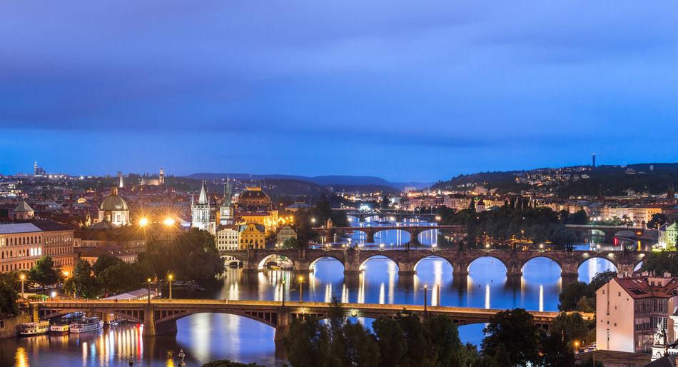 High angle view of bridges over vltava river against cloudy sky
