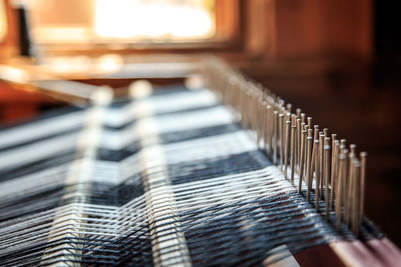 Close-up of loom at textile industry