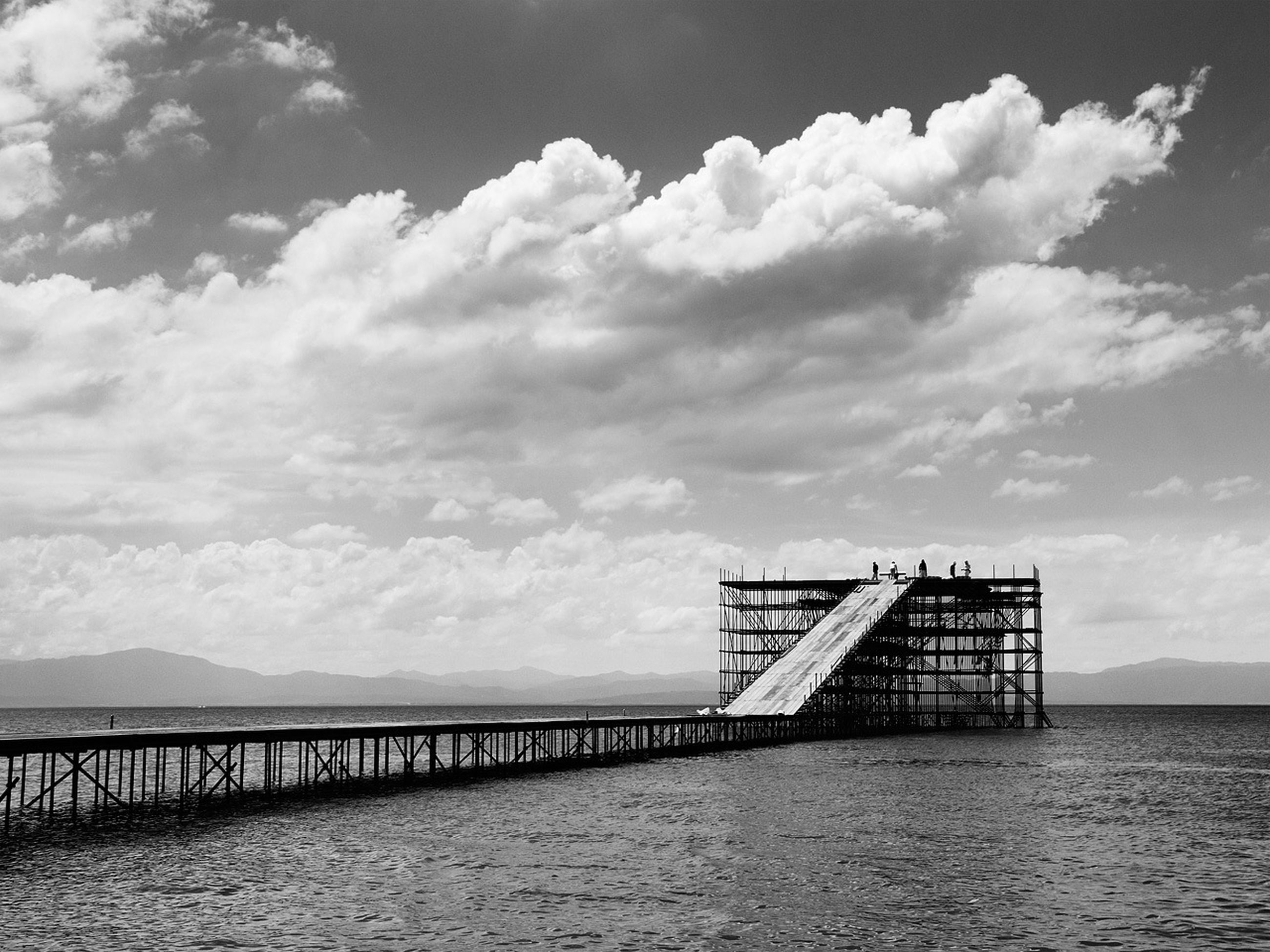sea, water, pier, sky, built structure, tranquility, horizon over water, tranquil scene, cloud - sky, scenics, railing, nature, jetty, cloudy, cloud, beauty in nature, architecture, beach, calm, waterfront