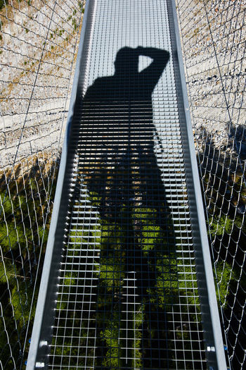 High angle view of woman standing on metal structure