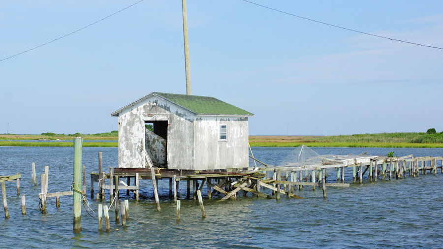 Tangier Island crab shack Chespeake Bay Crab Shack Tangier Island, Va Architecture Building Exterior Built Structure Commercial Fishing, Dock, Lobster, Lobstermen, Rope, Floats Stilt Water Wooden Post