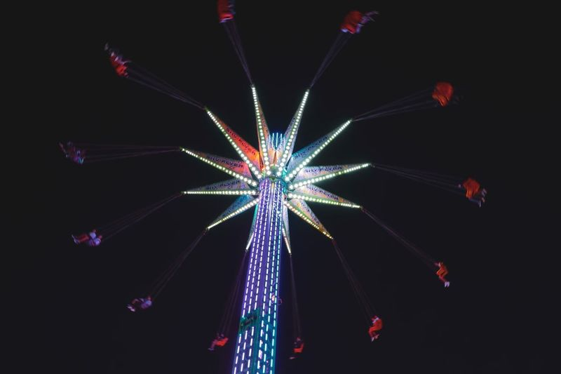 Ultimate swing Illuminated Night Celebration Arts Culture And Entertainment Glowing Low Angle View Event Motion Amusement Park Decoration Multi Colored Amusement Park Ride Light Lighting Equipment Outdoors