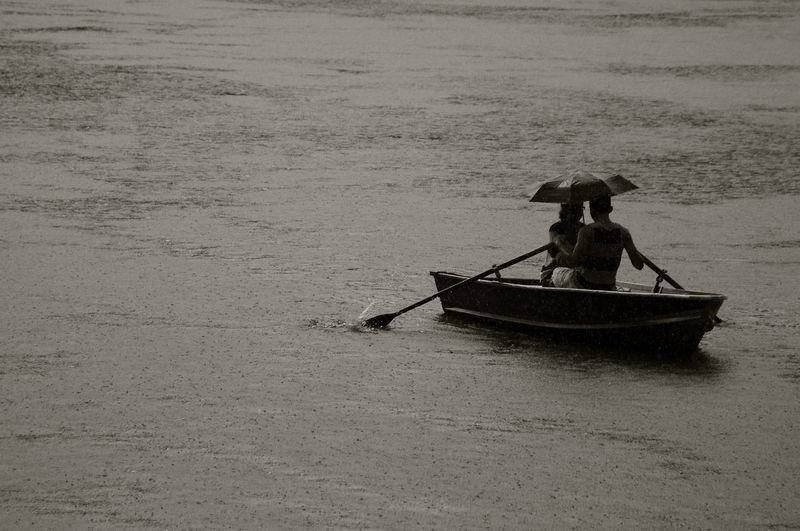 Man sitting on boat in sea