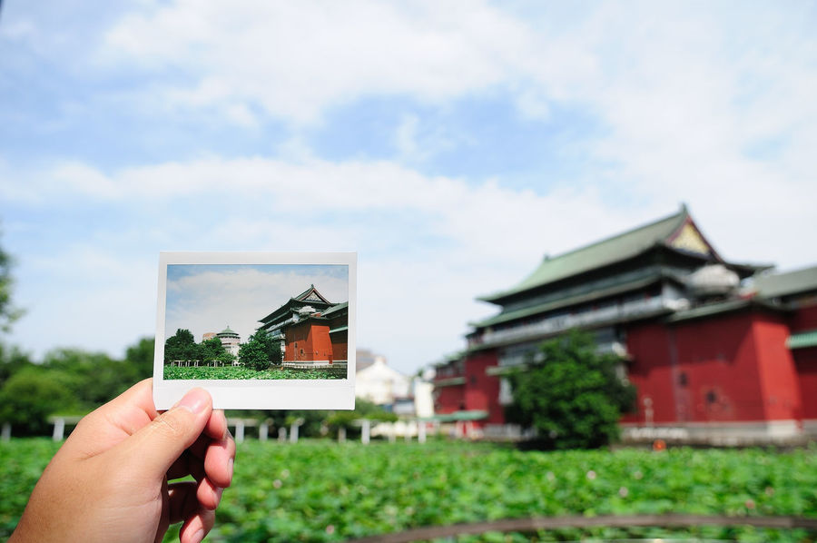 Taiwan Architecture Body Part Building Exterior Built Structure Cloud - Sky Day Finger Focus On Foreground Hand Holding Human Body Part Human Finger Human Hand Nature One Person Outdoors Photography Themes Plant Real People Sky Unrecognizable Person 台灣 植物園