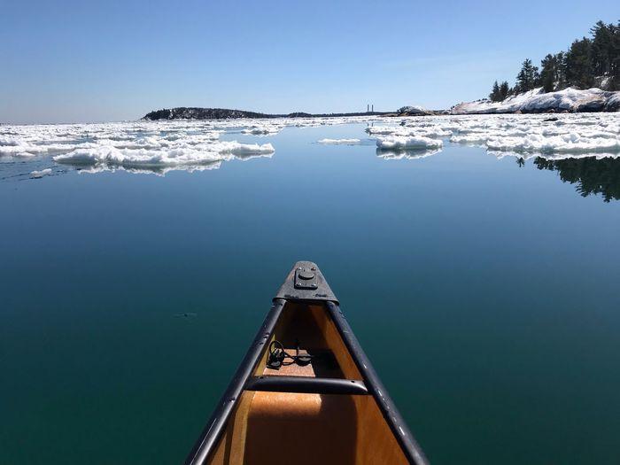 Sailboat on sea against clear sky