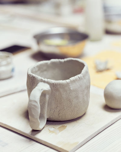 Close-up of clay cup on table
