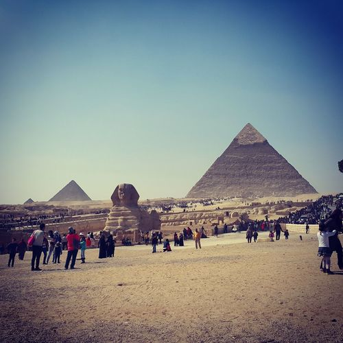 The great pyramids of egypt Pyramid Travel Destinations Ancient Civilization Desert Ancient Triangle Shape Architecture History Travel Sky Built Structure Outdoors Clear Sky Day The Great Outdoors - 2017 EyeEm Awards BYOPaper! Beauty In Nature Large Group Of People Domestic Animals Arid Climate News Event Animal Themes People