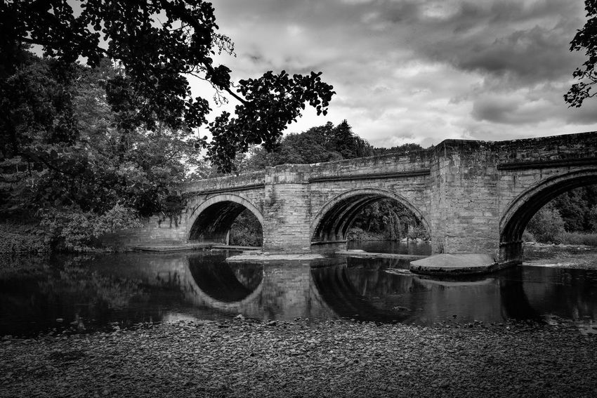 Water Reflections Water_collection Skyporn Trees And Sky Nikonphotography Blackandwhite Black & White Blackandwhite Photography Eye4photography  Clouds And Sky Countryside Landscape Sky_collection Sky And Clouds Water Tree Sky Plant Nature Cloud - Sky Built Structure Arch Arch Bridge Architecture Connection Reflection River Bridge