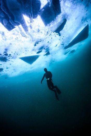 Person swimming undersea