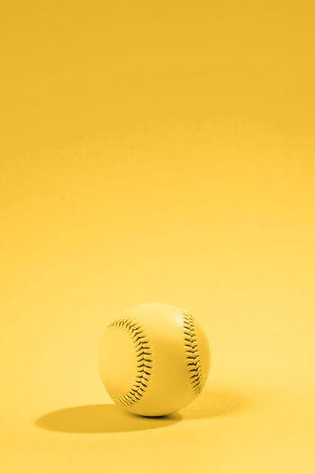 Close-up of ball on yellow background