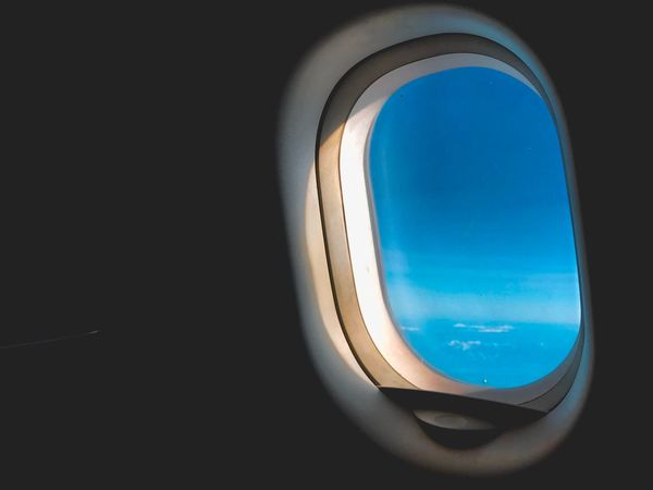 Airplane Vehicle Interior Transportation Air Vehicle Mode Of Transport Window Journey Travel Flying No People Commercial Airplane Sky Vehicle Seat Looking Through Window Close-up Aerial View Vehicle Part Airplane Seat Backgrounds Blue