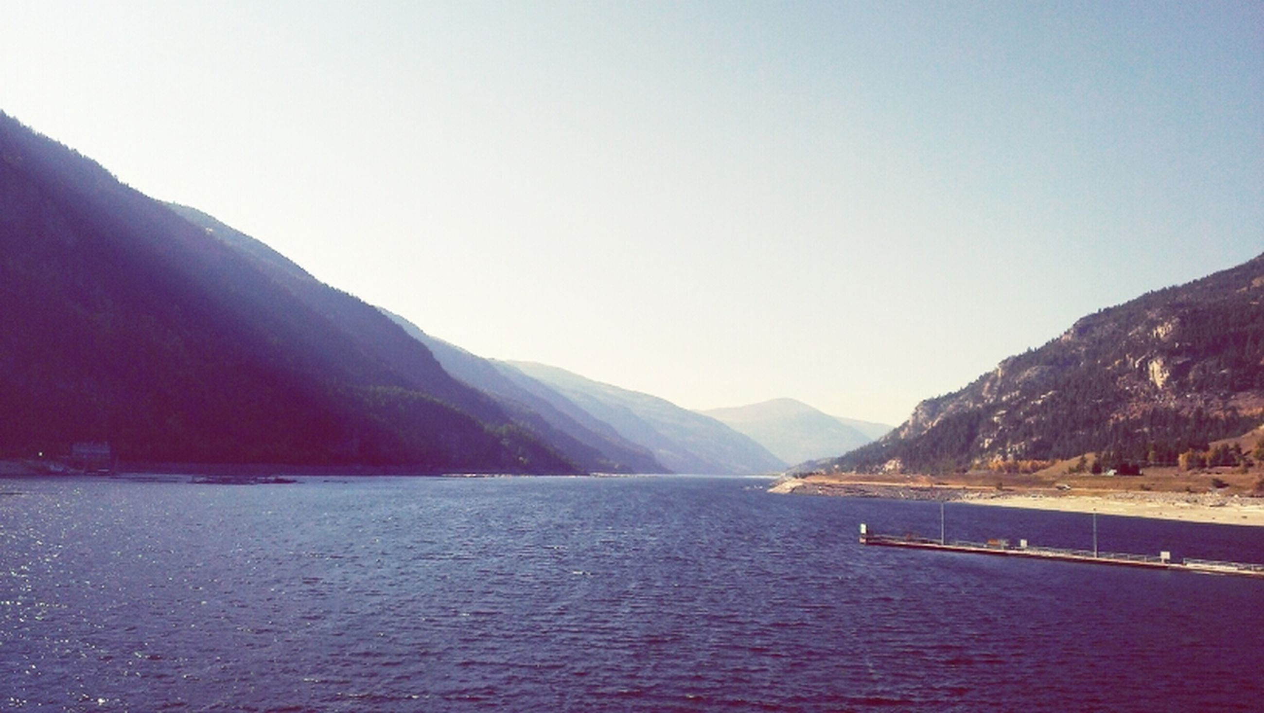 mountain, water, clear sky, tranquil scene, mountain range, scenics, tranquility, copy space, beauty in nature, lake, waterfront, nature, river, idyllic, non-urban scene, sea, outdoors, no people, landscape, day