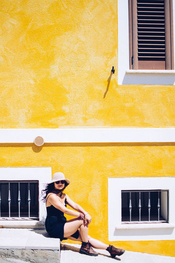 Yellows of Sardinia Bright Hat Holiday Vacations Woman Architecture Building Exterior Built Structure Day Girl Island Lifestyles One Person Outdoors Real People Sardegna Sardinia Summer Vacation White Woman Portrait Yellow Young Adult Young Woman Young Women