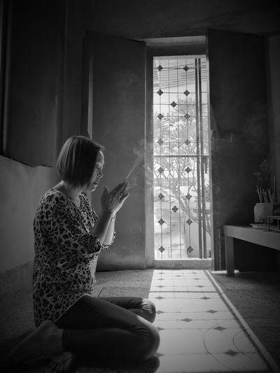 Woman praying at home at home