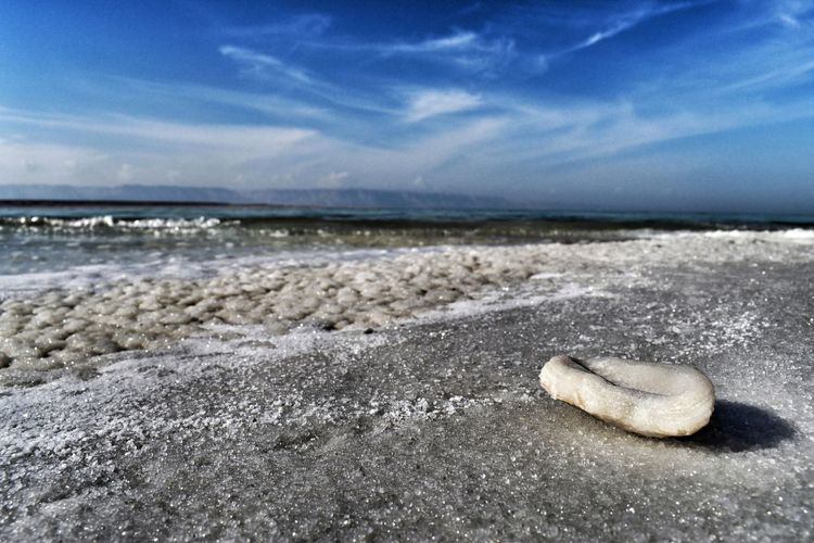 Beach Sea Land Sky Water Beauty In Nature Sand Nature Scenics - Nature Horizon Over Water Horizon Cloud - Sky Rock No People Tranquility Solid Day Tranquil Scene Wave Outdoors Surface Level Pebble