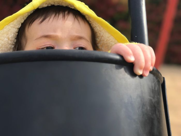 Close-Up Of Child Looking Away In Play Equipment