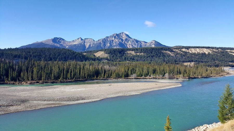 Scenic View Of Athabasca River Against Sky