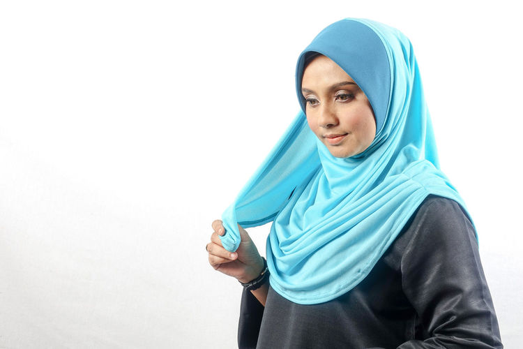 Smiling Woman Wearing Hijab Against White Background