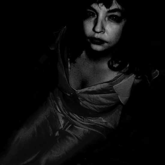 Black Background Portrait Beautiful Woman Young Women Beauty Women Beautiful People Females Studio Shot Headshot Fine Art Portrait Monochrome Film Noir Style Mafia  Shoulder Haute Couture Mug Shot Chiaroscuro  Hollywood - California Artist's Model Fashion Model Loneliness Thinking Organized Crime Thoughtful Depression - Sadness Gangster Blue Color My Best Photo
