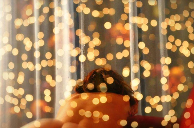 Defocused image of woman lights