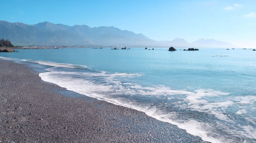 Water Sea Scenics - Nature Mountain Beauty In Nature Sky Tranquil Scene Tranquility Land Nature Day Outdoors Kaikoura Kaikoura New Zealand Waves Morning Sun Morning Blue Mountains New Zealand No People Landscape Beach Sport Motion Aquatic Sport Surfing Mountain Range Wave