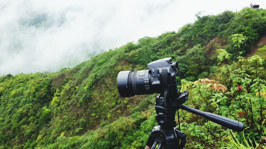 Camera On Mountain During Foggy Weather