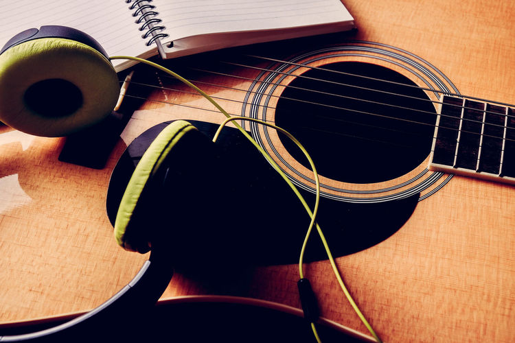Acoustic Guitar Arts Culture And Entertainment Brown Close-up Fretboard Guitar High Angle View Indoors  Music Musical Equipment Musical Instrument Musical Instrument String No People Paper Still Life String String Instrument Table Wood - Material Woodwind Instrument