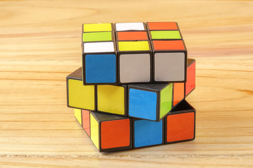 RUBIK'S CUBE , CREATIVITY TOY Creativity Rubik Cube Arrangement Block Choice Close-up Creativity Design Focus On Foreground Geometric Shape Indoors  Intelligence Large Group Of Objects Multi Colored No People Rubik Shape Stack Still Life Table Toy Toy Block Variation Wood - Material