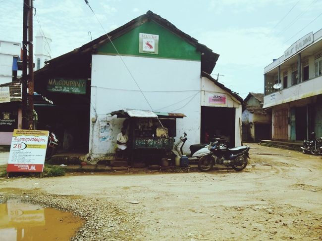 Architecture Transportation Road House Day Outdoors Cloud - Sky In Front Of Dirty Market Vendor Small Shop Sunny☀ Shadow Puddle Messy Obsolete Building Exterior