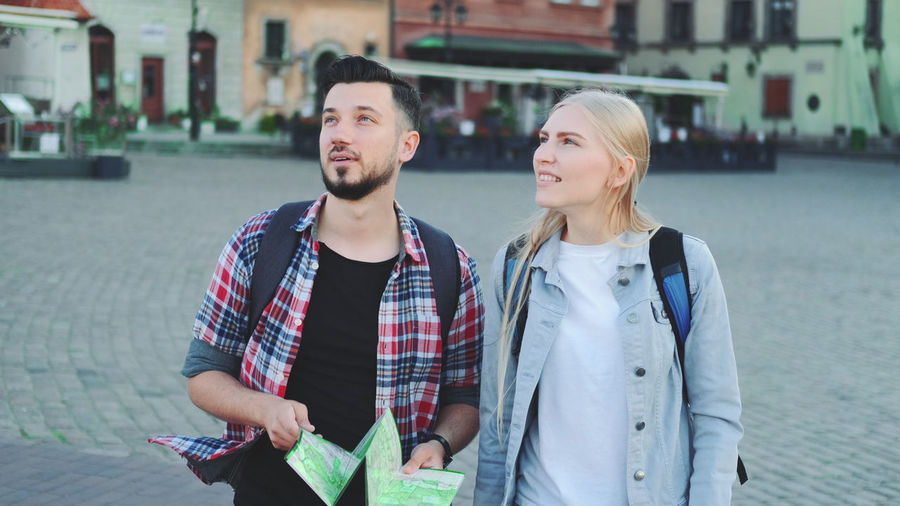 Young couple smiling in city