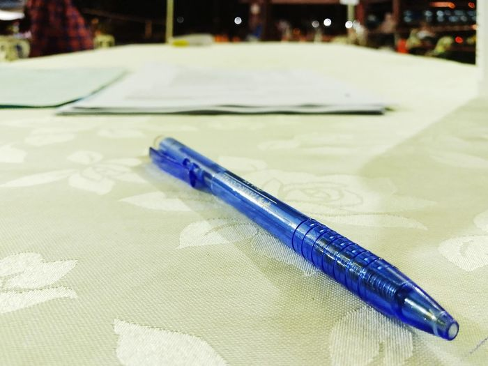 Close-up of blue paint on table
