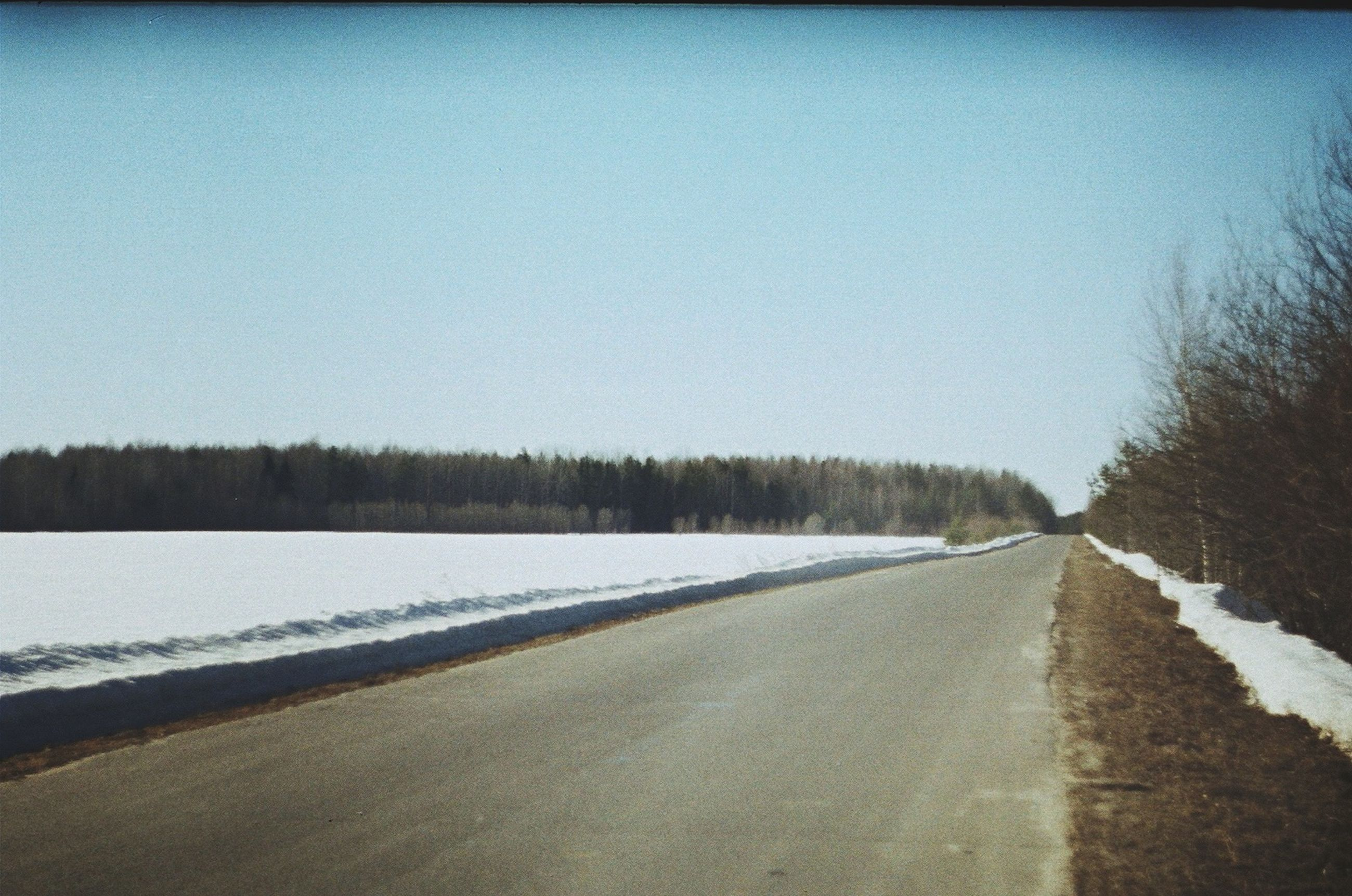 snow, winter, the way forward, cold temperature, road, clear sky, diminishing perspective, transportation, vanishing point, season, copy space, tranquil scene, tree, weather, tranquility, nature, landscape, country road, covering, beauty in nature