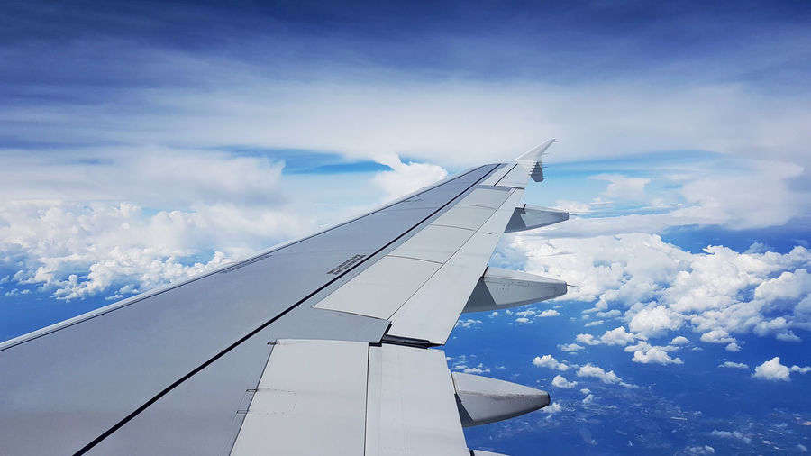 In the air Airplane Blue Cloud Cloudscape Day Flying Journey Mode Of Transport Sky Travel