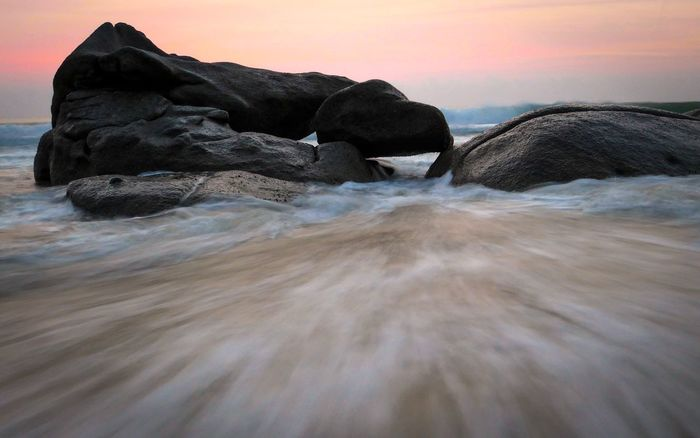 Water Sky Sea Beach Beauty In Nature Land Sunset Rock Nature Scenics - Nature Motion Rock - Object Tranquility Horizon Over Water Solid No People Tranquil Scene Wave Horizon Outdoors