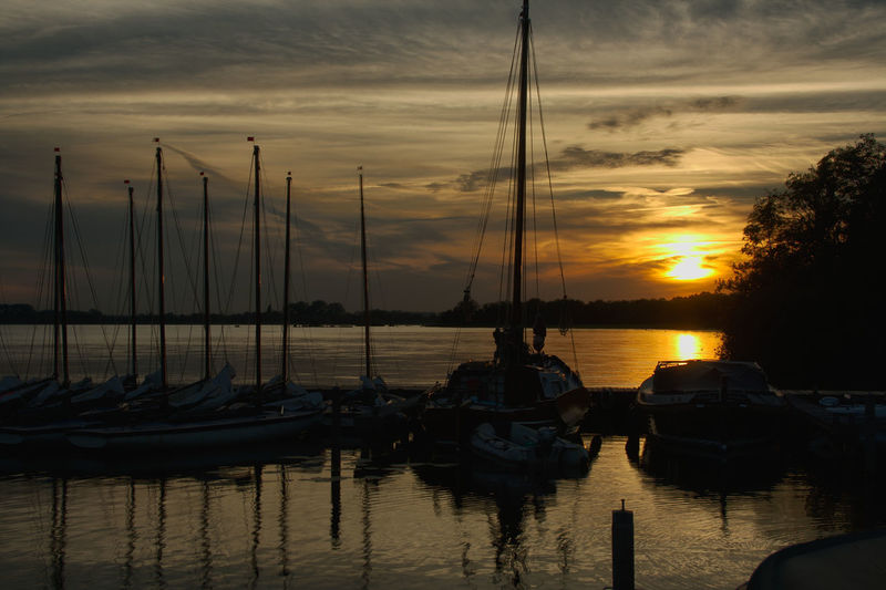 Beauty In Nature Boat Cloud - Sky Harbor Mast Mode Of Transport Moored Nature Nautical Vessel No People Orange Color Outdoors Reflection Sailboat Scenics Sea Silhouette Sky Sun Sunlight Sunset Tranquil Scene Tranquility Transportation Water