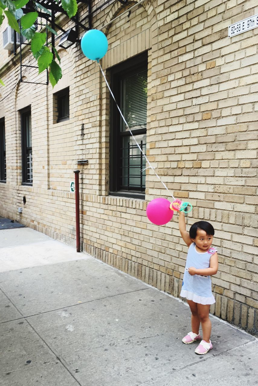 balloon, architecture, full length, helium balloon, childhood, building exterior, real people, girls, day, celebration, outdoors, built structure, happiness, bubble wand, people