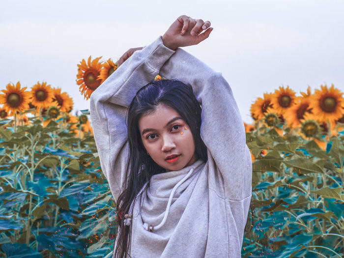 put your hand in the air Portrait One Person Looking At Camera Real People Child Front View Waist Up Leisure Activity Childhood Girls Lifestyles Plant Standing Flowering Plant Casual Clothing Flower Day Nature Outdoors Human Arm Teenager Sunflower EyeEm Best Shots Getty Images Love