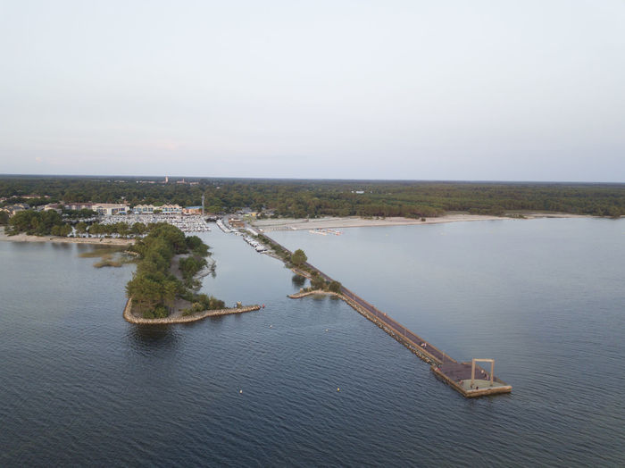 High angle view of pier amidst lake against sky